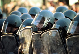 ANTI RIOT POLICEMEN BLOCK A WAY TO OPPOSITION SUPPORTERS