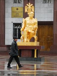 Man walks past golden statue of former Turkmen President Niyazov in Ashgabat