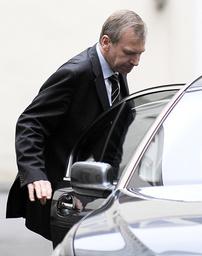 Belgium's PM Leterme leaves his office in Brussels