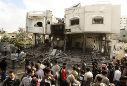 Palestinians look at house destroyed after Israeli air strike in Rafah