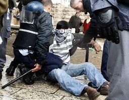 Israeli police officers detain Palestinian demonstrator in Jerusalem