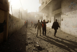 Palestinian rescue workers survey scene after air strike in Rafah