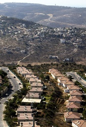 THE JEWISH SETTLEMENT ELI IS SEEN IN FRONT A PALESTINIAN VILLAGE IN THE WEST BANK