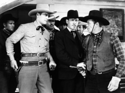 TWO-FISTED RANGERS, front from left: Charles Starrett, Kenneth MacDonald, Dick Curtis, 1939