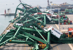 GIANT CONTAINER CRANES LIE DESTROYED BY TYPHOON MAEMI IN THE SOUTHERN PORT CITY OF PUSAN