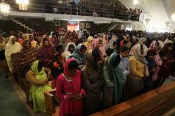 Pakistani Christians pray during Christmas mass at Fatima Church in Islamabad