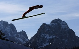 Germany's Uhrmann soars over Germany's highest mountain Zugspitze and Waxenstein during the second practice of the four-hills ski jumping tournament in Garmisch-Partenkirchen