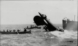 A Salvage Worker Making His Perilous Way Up The Stern Of Stricken Submarine Hms Thetis In An Affort To Make Fast A Hawser Hms Thetis (n25) Was A Group 1 T-class Submarine Of The Royal Navy Which Served Under Two Names. Under Her First Identity Hms Th