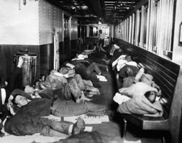 Homeless people stay overnight on a steamer during the Great Depression, 1930