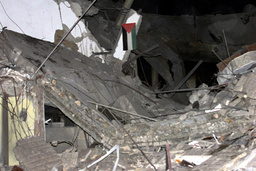 PALESTINIAN FLAG IS SEEN AMONGST REMAINS OF POLICE STATION AFTER ISRAELI AIR CRAFT ATTACK
