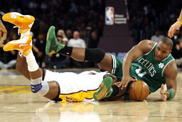 Boston Celtics' Davis tries to grab the ball as Lakers' Odom is called for a loose ball foul during their NBA basketball game in Los Angeles