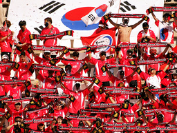 SOUTH KOREA SUPPORTERS CHEER FOR THEIR TEAM DURING A FRIENDLY SOCCER MATCH AGAINST FINLAND IN CARTAGENA