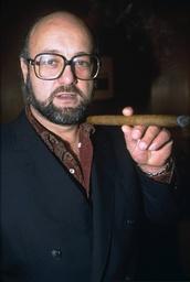 MILLIONAIRE PETER DE SAVARY RECEIVING BIG CIGAR FROM DAVIDOFF