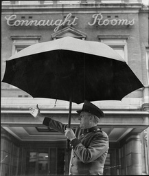 Doorman With Umbrella Outside Connaught Rooms London 1960.