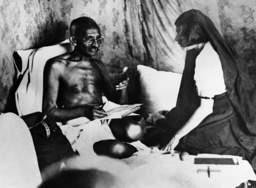 Mahatma Gandhi gives Mrs. Perin directions shortly before his arrest, 1932