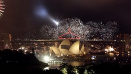 Fireworks explode over the Sydney Opera House and Harbour Bridge during New Year's eve celebrations