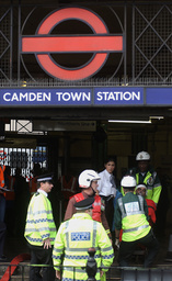 BRITISH EMERGENCY WORKERS CARRY AN INJURED MAN OUT OF CAMDEN TUBE STATION IN LONDON