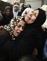 Palestinian relatives of Qanan mourn during funeral in Gaza