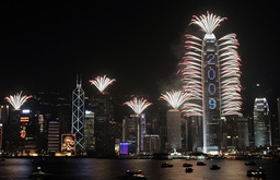 Firework explode off and around the IFC, the tallest commercial building in Hong Kong, during New Year celebrations
