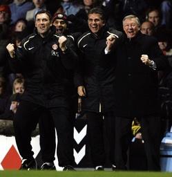 Manchester United's manager Ferguson celebrates a goal against Aston Villa during their English Premier League match in Birmingham