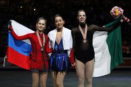 Winners Asada, Lipnitskaia and Kostner pose during the award ceremony at the ISU World Figure Skating Championships in Saitama