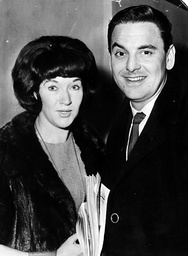Comedian / Entertainer Bob Monkhouse With His 1st Wife Elizabeth Monkhouse At London Heathrow Airport Leaving For Barbados.
