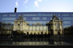 France. Nord (59). Lille. Palais des Beaux-Arts reflection in new construction's glazed facade built face to face of Palace by architects Jean-Marc Ibos et Myrto Vitart
