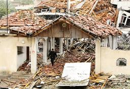 Palestinian man walks in ruins of destroyed office of Haniyeh in Gaza