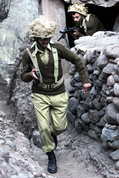 PAKISTANI SOLDIERS RUN OUT THEIR BUNKER IN CHAKOTHI, PAKISTANI CONTROLLED KASHMIR
