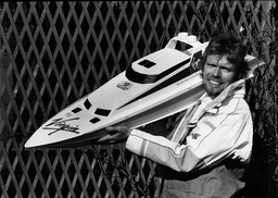 Richard Branson With A Model Of The Challenger Ii.