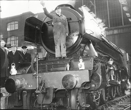 The Flying Scotsman At Kings Cross Station Where Alan Pegler At The Front Of The Engine.