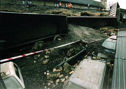 CARS LIE CRUSHED UNDER FREIGHT WAGONS AT BEXLEY
