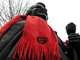 Music fan leaves scarf that says Godfather on statue of deceased singer James Brown, in his hometown of Augusta