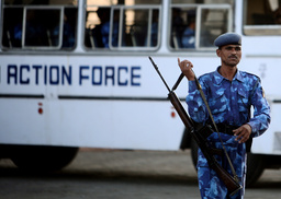 A Rapid Action Force personnel stands guard outside the Taj Mahal hotel in Mumbai
