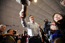 Republican presidential candidate and former Massachusetts Governor Mitt Romney greets voters at a campaign rally in Davenport