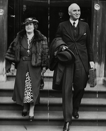 Sir John Simon The Chancellor Arrives At The House Of Commons With The Despatch Box And His Wife.