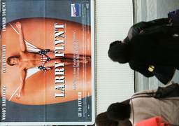 PEDESTRIANS WALK NEAR LARRY FLYNT FILM POSTER IN PARIS
