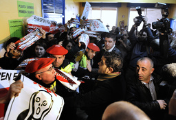 Police hold back banned pro-independence party D3M protesters as PSE leader Patxi Lopez votes in Bilbao