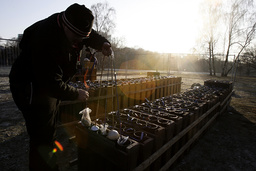 A pyrotechnician loads mortars for the New Year's Eve celebrations in Berlin