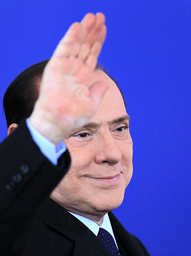 Italy's PM Berlusconi waves hand to onlookers as he arrives for the second day of the G20 Summit in Cannes