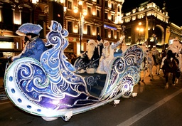Participants dressed up as Father Frost and Snow Maiden take part in a parade in central St. Petersburg