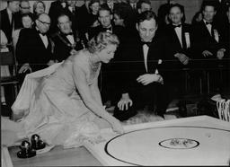 Lady Docker (norah Collins) Wife Of Industrialist Sir Bernard Docker (not Shown) With Cricketer Len Hutton Playing Marbles 1954.