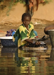 A girl washes clothes in the Niger River, near Niamey