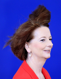 The wind blows the hair of Australia's PM Gillard as she arrives for the second day of the G20 Summit in Cannes