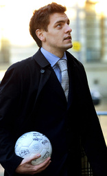 LEEDS UNITED PLAYER WOODGATE CARRIES A SIGNED FOOTBALL AS HE ARRIVES AT HULL CROWN COURT