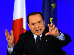 Italy's Prime Minister Berlusconi gestures during a news conference at the end of the G20 Summit in Cannes