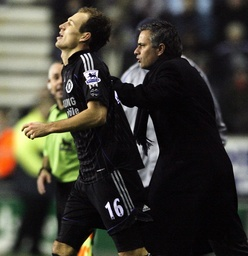 Chelsea's Robben celebrates with manager Mourinho after scoring during their English Premier League soccer match against Wigan Athletic in Wigan