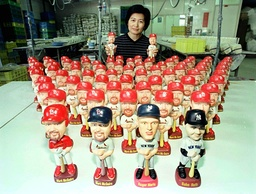 JOICEY HWANG SHOWS OFF 70 CHINA DOLLS OF HOME RUN KING MARK MCGWIRE IN MIAOLI