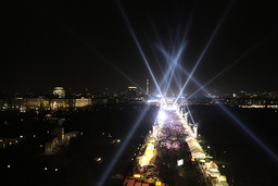 A general overview shows the illuminated fanmile next to the Brandenburg Gate in Berlin