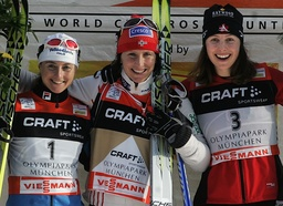 Norway's Bjoergen, Italy's Follis and Canada's Crawford celebrate on the podium after the first of four 'Tour de Ski' Cross Country World Cup competitions in Munich's Olympic stadium